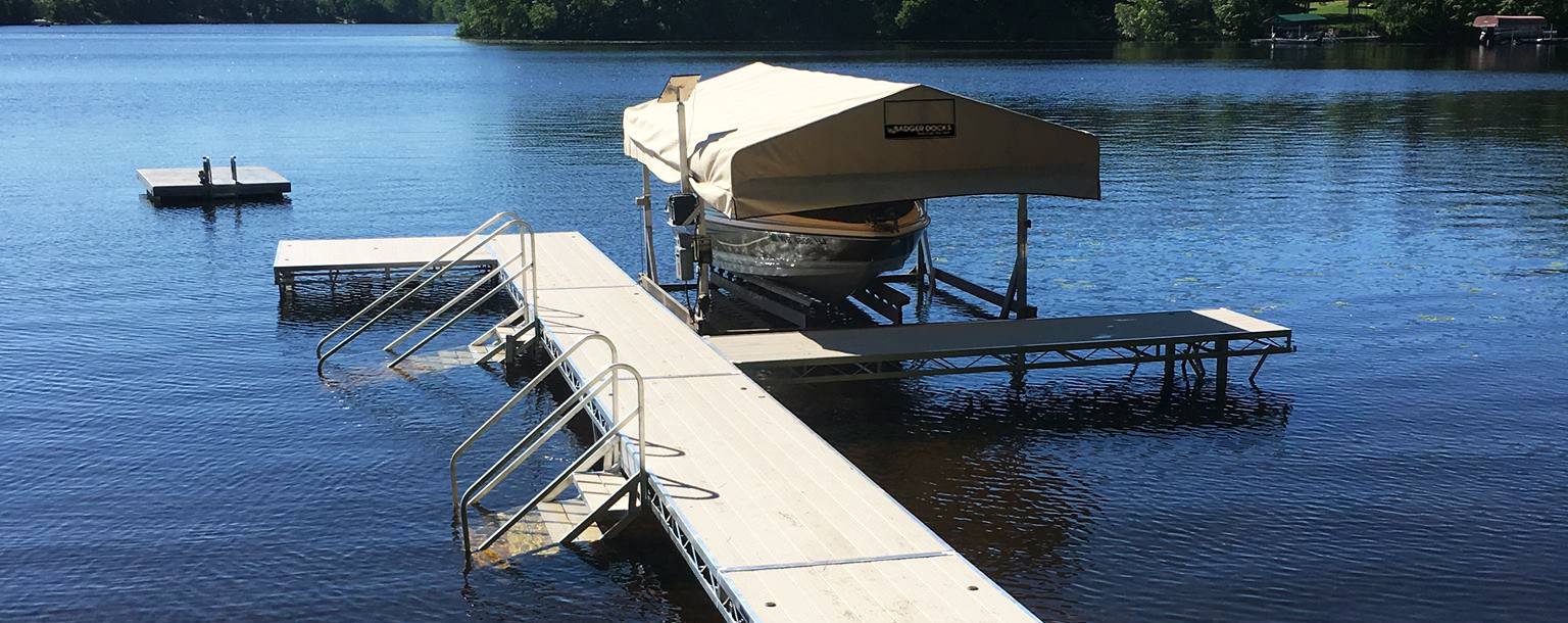 New dock and lift housing an expensive boat